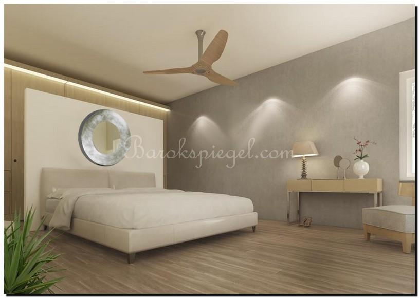 ronde design spiegel in slaapkamer