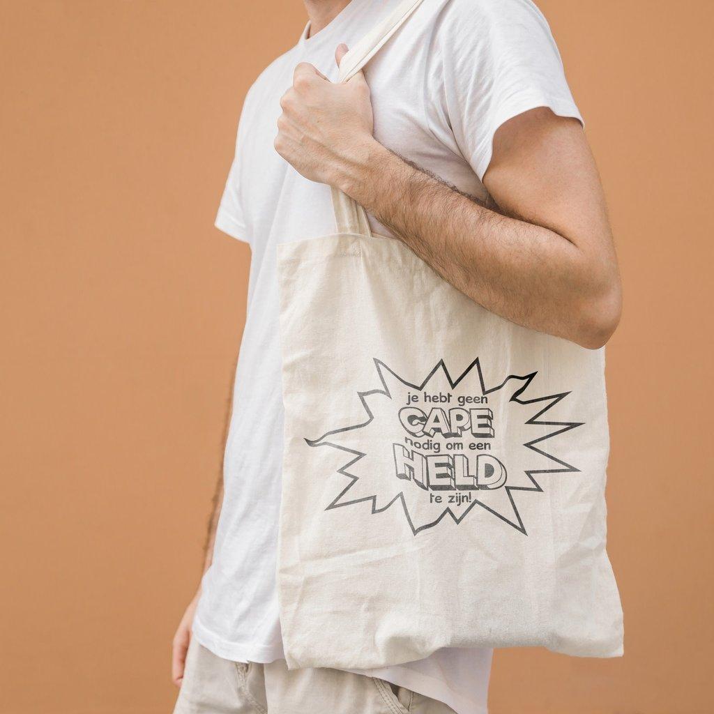 Held zonder cape! Buy one, give one; Held zonder cape tas!