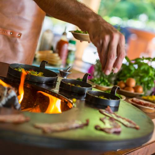 Vuurschalen en vuurkorven - genieten en koken van de warmte van open vuur