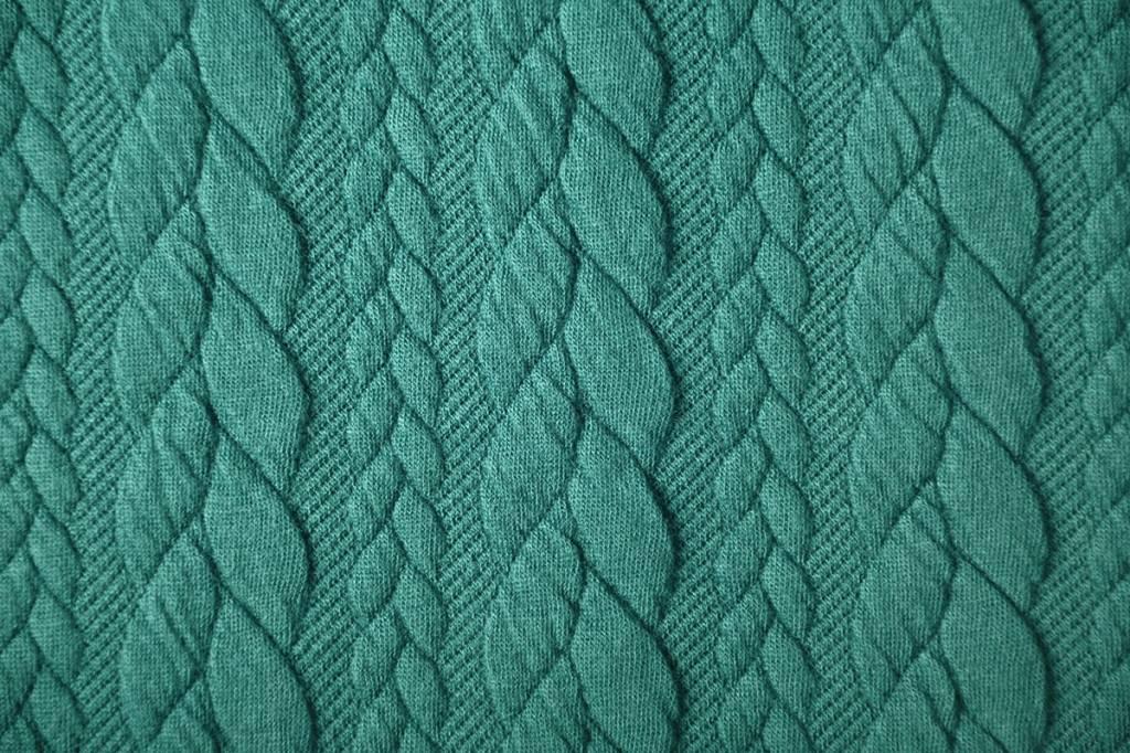 Gebreide kabel stof tricot Zeegroen