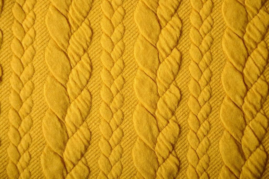 Gebreide kabel stof tricot Oker