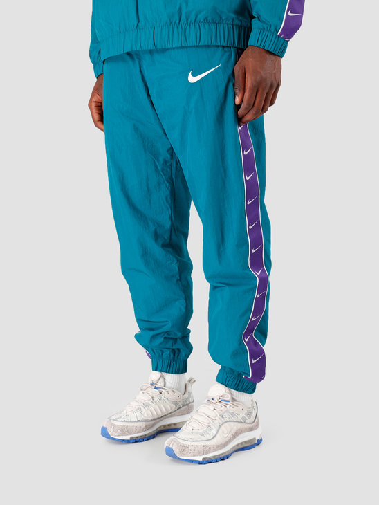Nike NSW Swoosh Pant Wvn Geode Teal Court Purple White CD0421-381