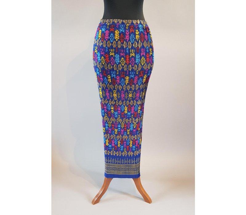 Kebaya elegant fuchsia met bijpassende sarong plissé