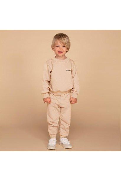 &C x REVIVE joggingset take it easy soft beige