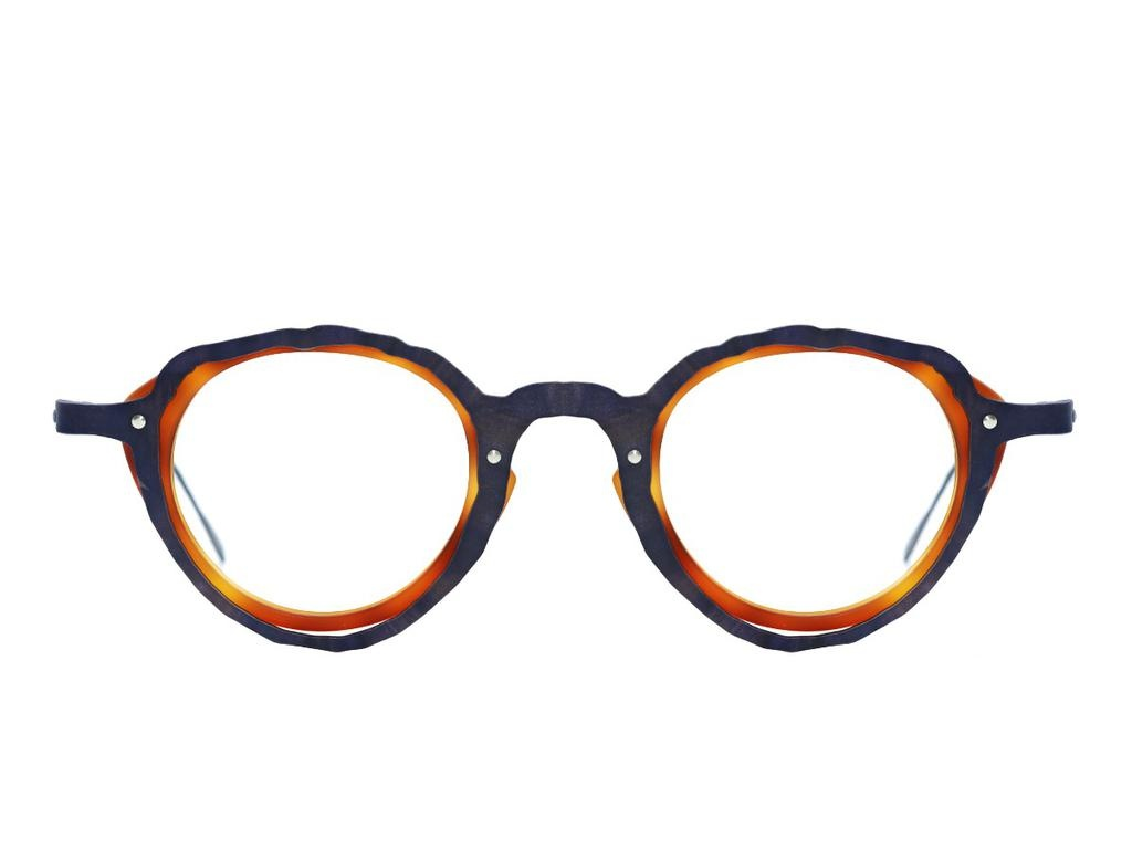 Theo All Eye Witness frames by Theo are subtly asymmetric. This pair are made from tortoiseshell acetate with a brown titanium front overlay. The temples are also titanium.<br /> <br /> Theo colour code 9.
