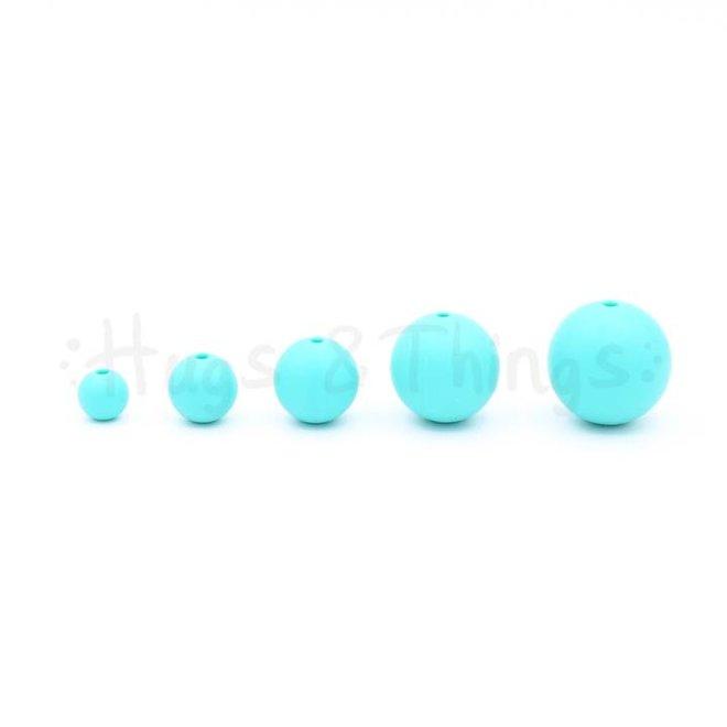 15 mm - Zachtturquoise Spikkels