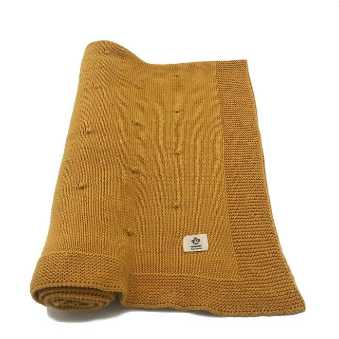 Okergele deken met bolletjes