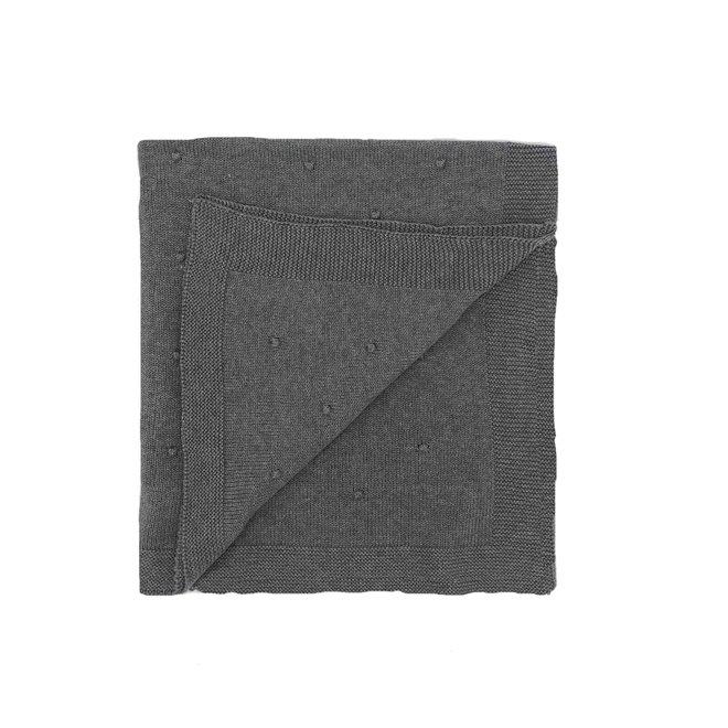 Grijze deken met bolletjes