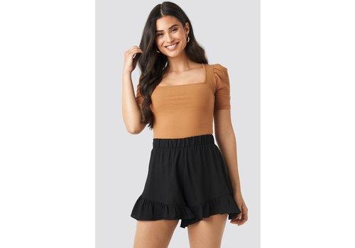 NA-KD ruffle shorts