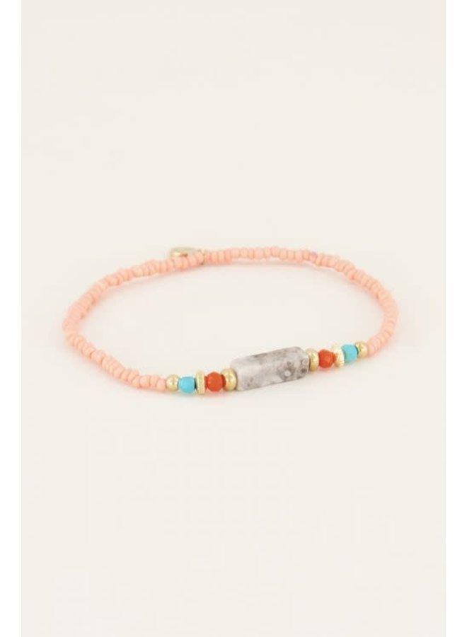 Armbandje met roze kralen - Goud