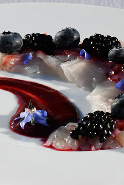 Bream carpaccio with borage black berries