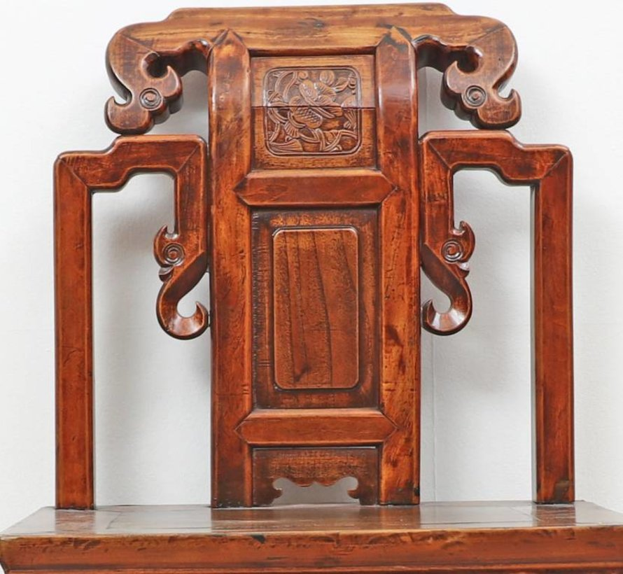 Antique Chinese chair with carved backrest