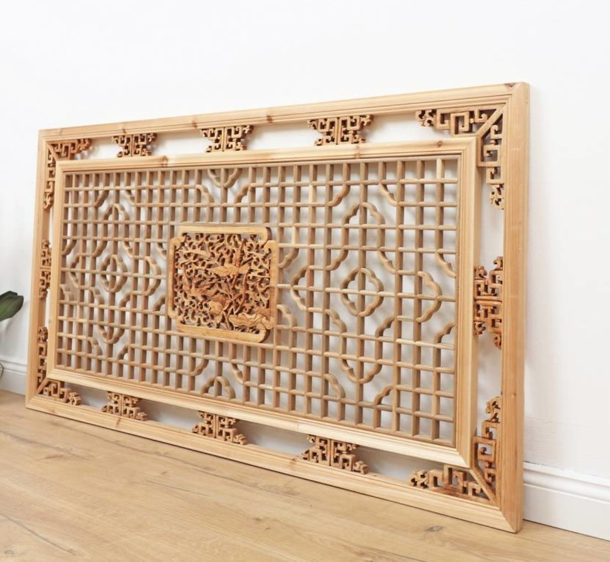 Classic wood carvings with floral and geometrical motives