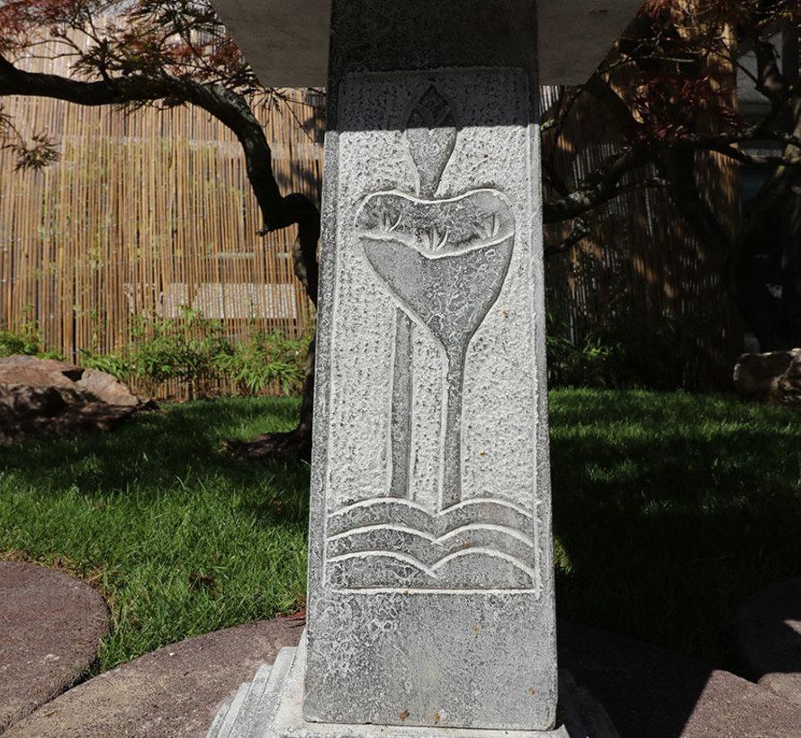 Chinese stone lantern with lotus motif represents auspicious