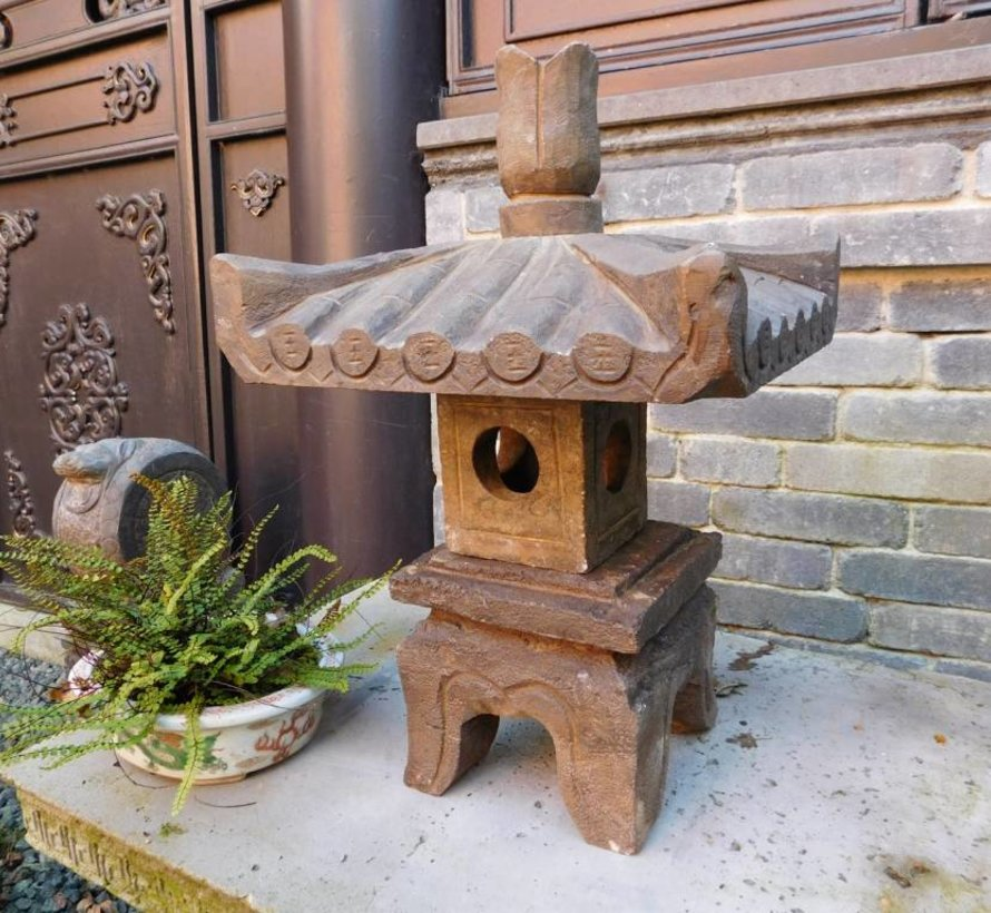 little Stone lantern made of natural stone with square roof