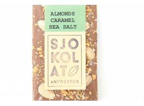 SJOKOLAT A bar of milk chocolate with almonds, caramel and seasalt