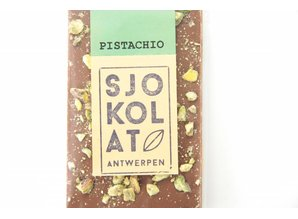 SJOKOLAT A bar of milk chocolate with pistachio nuts