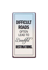"""La Finesse magnet with text """"difficult roads often lead to …"""""""
