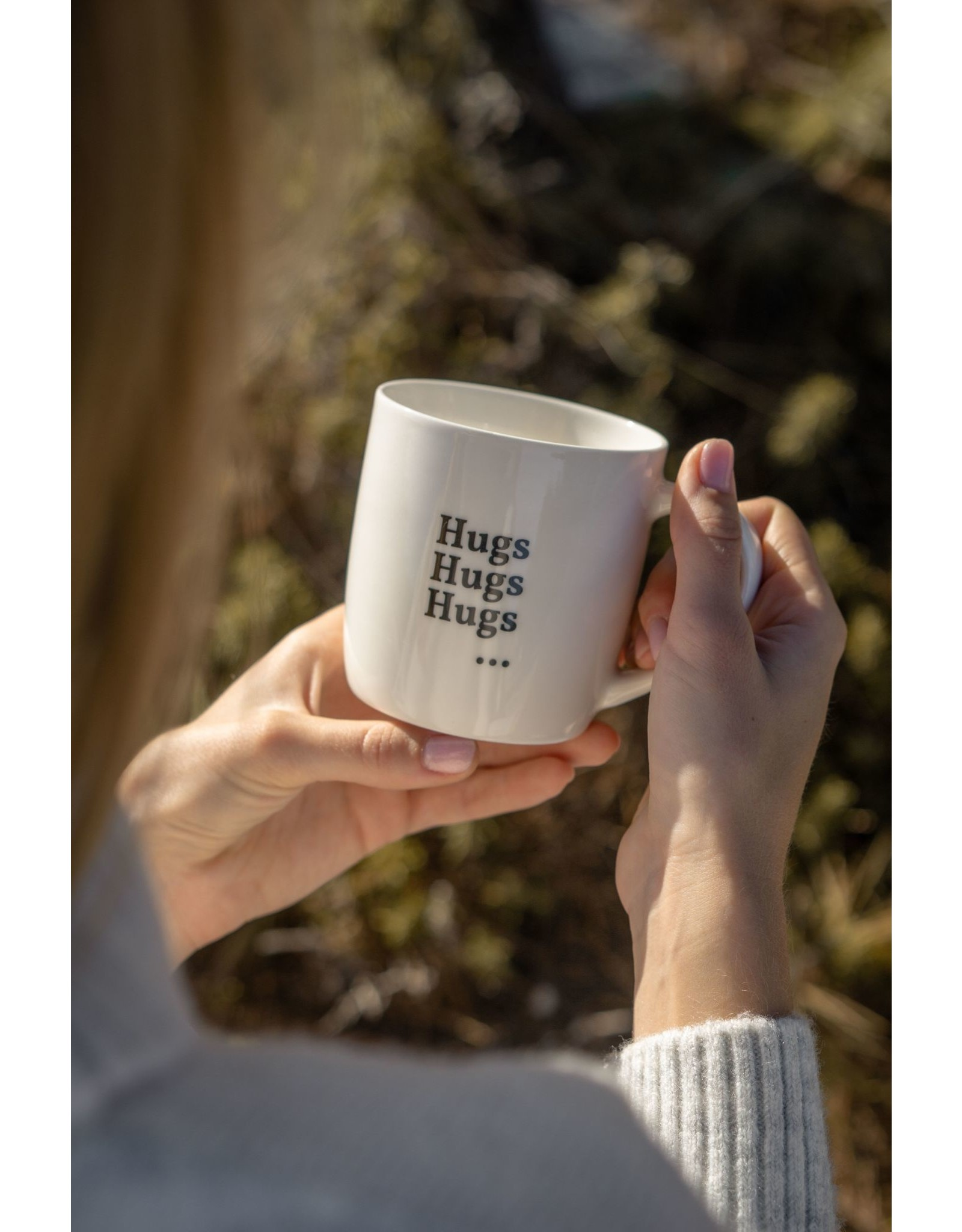 """drinking cup with text """"hugs hugs hugs ..."""""""