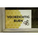 Plakkaat voorzichtig bijen