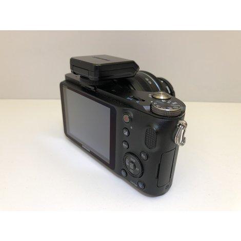Samsung NX200 + 50-200mm + 20-50mm camera