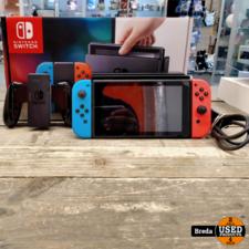 Nintendo Switch Console, 32GB + Neon Rode/Blauwe Joy-Con, Met Doos   Incl. garantie