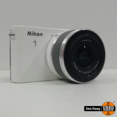 Nikon 1 J1 Zwart + 1 Nikkor VR 10-30 mm + extra 35mm lens
