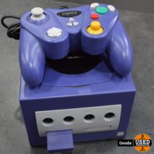 Game cube paars met kabels en controller