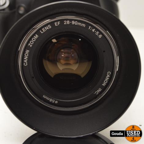 Canon EOS 450D met Canon Zoom Lens 28-90 mm 1:4-5.6. Met 2 accu's lader compleet in doos met boek