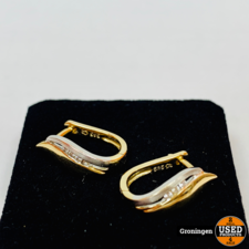 Gouden oorstekerset 14 karaat met briljantjes   585/1000   2,47 gram