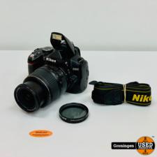 Nikon Nikon D3000 body [36.810 clicks] + AF-S 18-55mm 1:3.5-5.6 G II ED | incl. accu, Jupio-lader en schouderriem