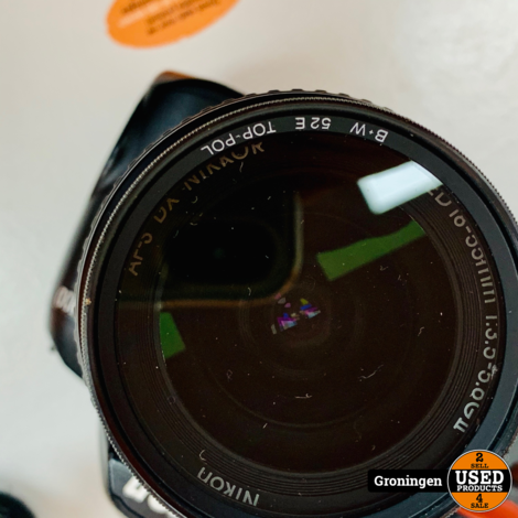 Nikon D3000 body [36.810 clicks] + AF-S 18-55mm 1:3.5-5.6 G II ED | incl. accu, Jupio-lader en schouderriem