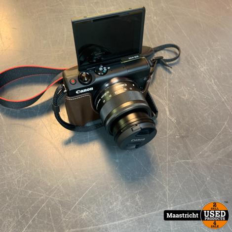 Canon EOS M100 Zwart + 15-45mm f/3.5-6.3 Zwart + Beschermhoes Zwart   nwpr 399 euro