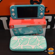 Nintendo Switch Lite Turquoise in doos incl. hoesje en lader - klein spoortje op scherm