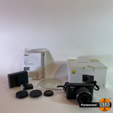 Nikon Nikon J1 Camera + Nikkor 10-30MM Lens 2 accu's
