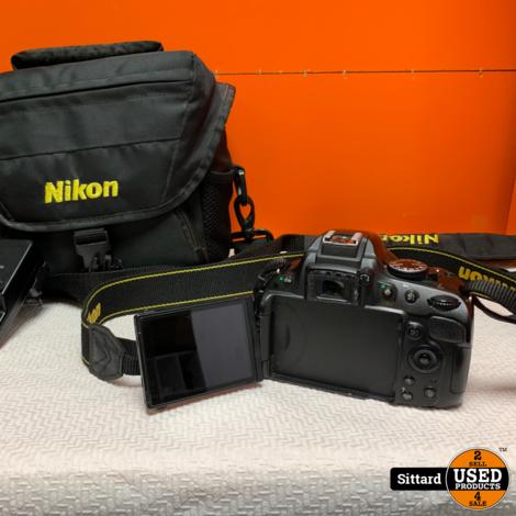 Nikon D5100 + Nikon Lens AF-S Nikkor 35mm 1:1.8G + opberghoes