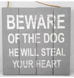 Beware of the dog he will steal your heart
