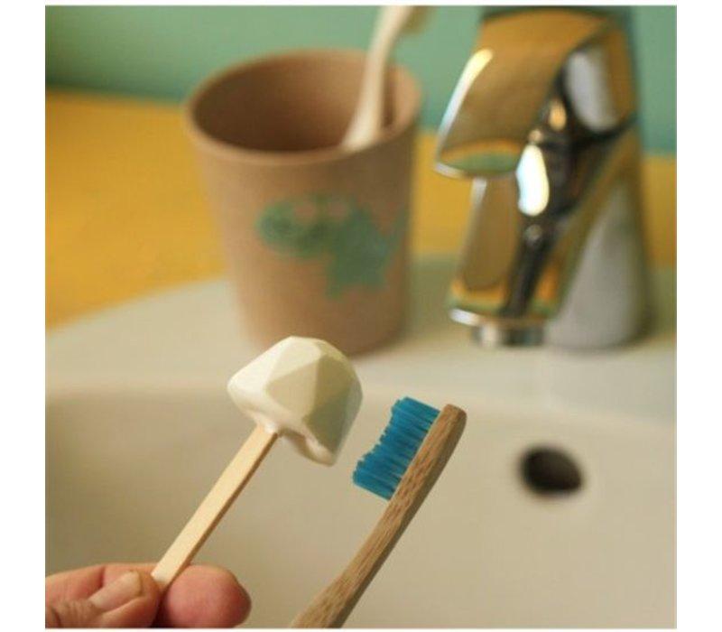 Tandpasta op een stokje