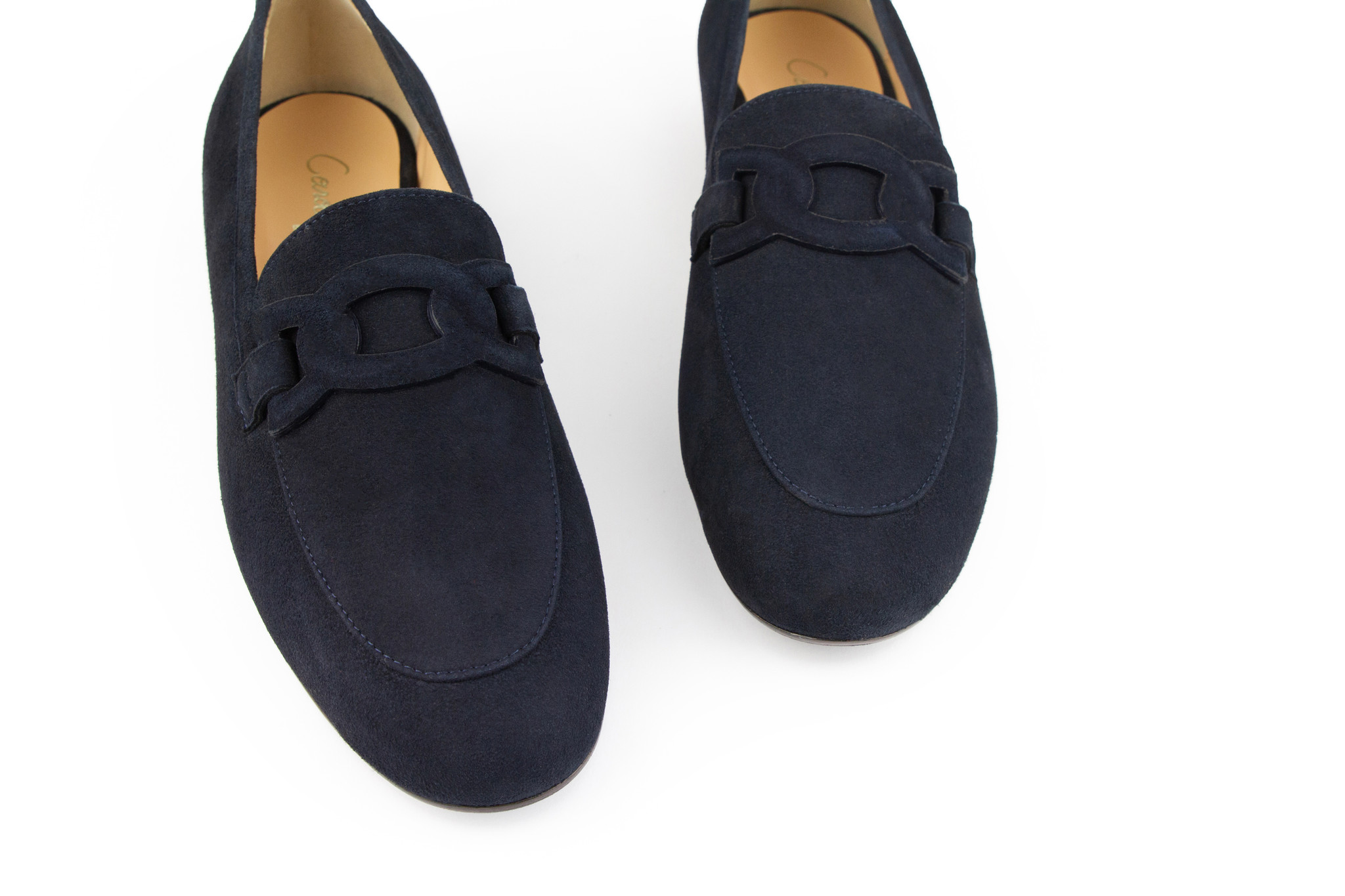 women in navy blue suede leather