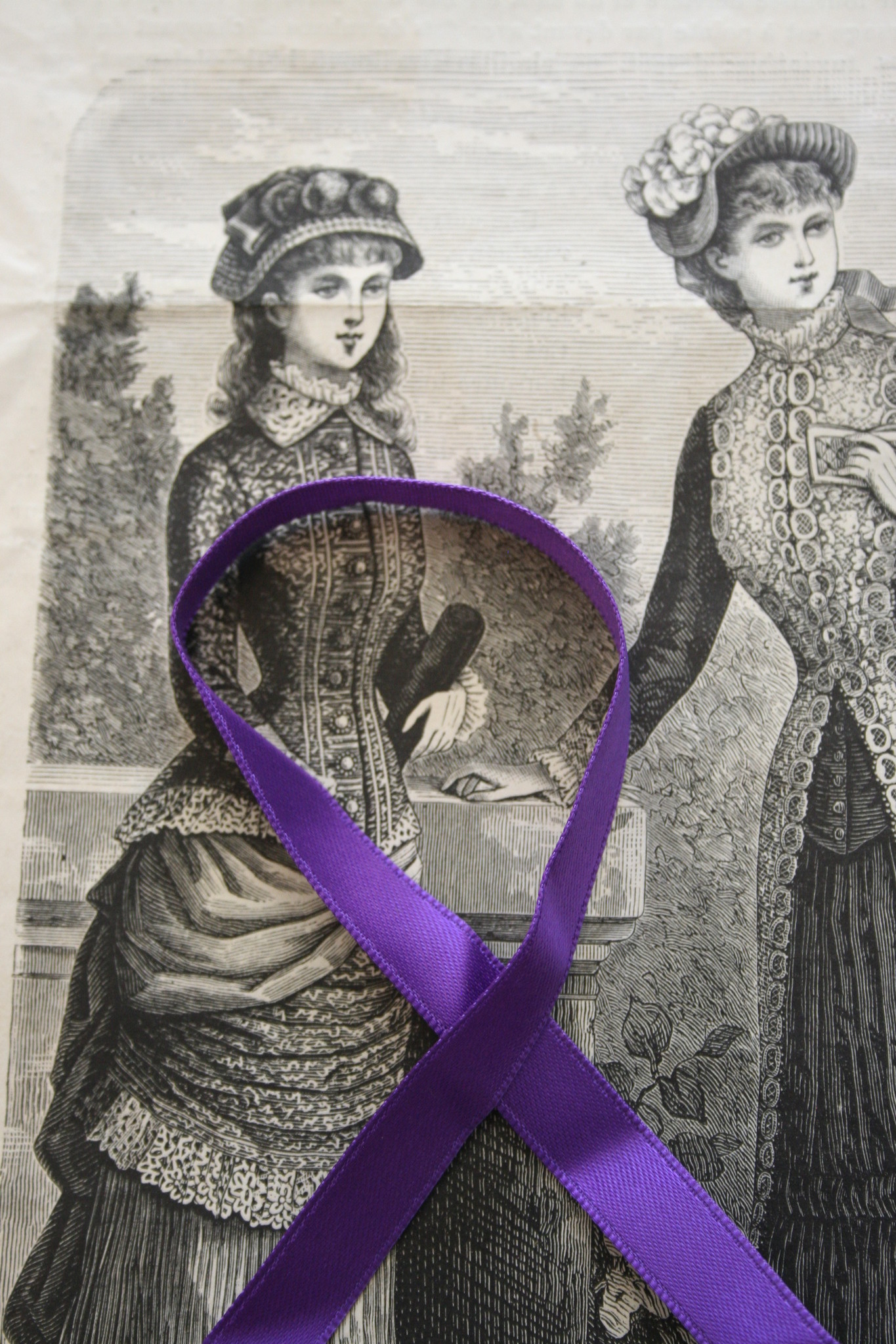 Purple double sided satin ribbon in different widths.