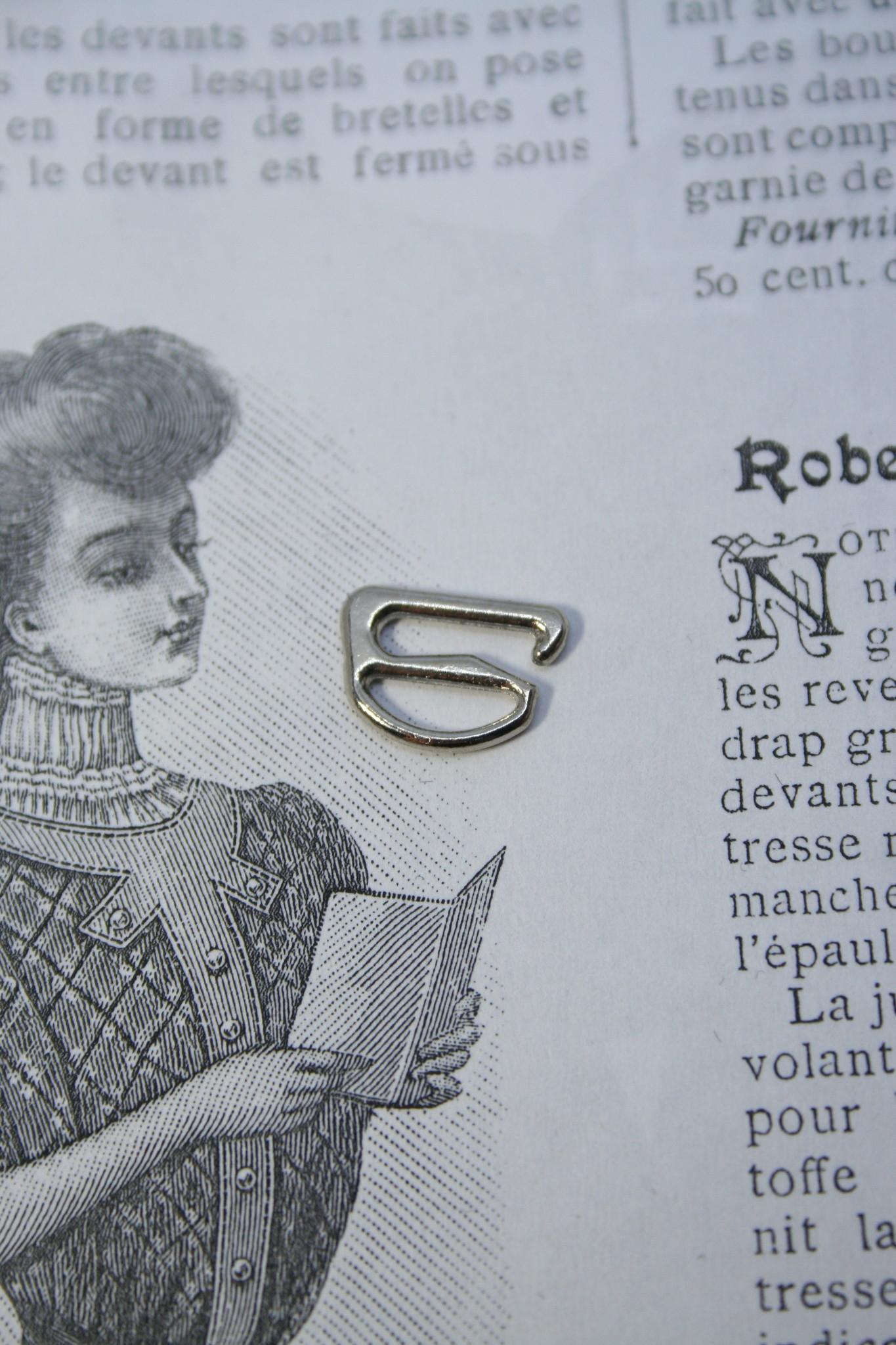 Silver small lingerie hooks.