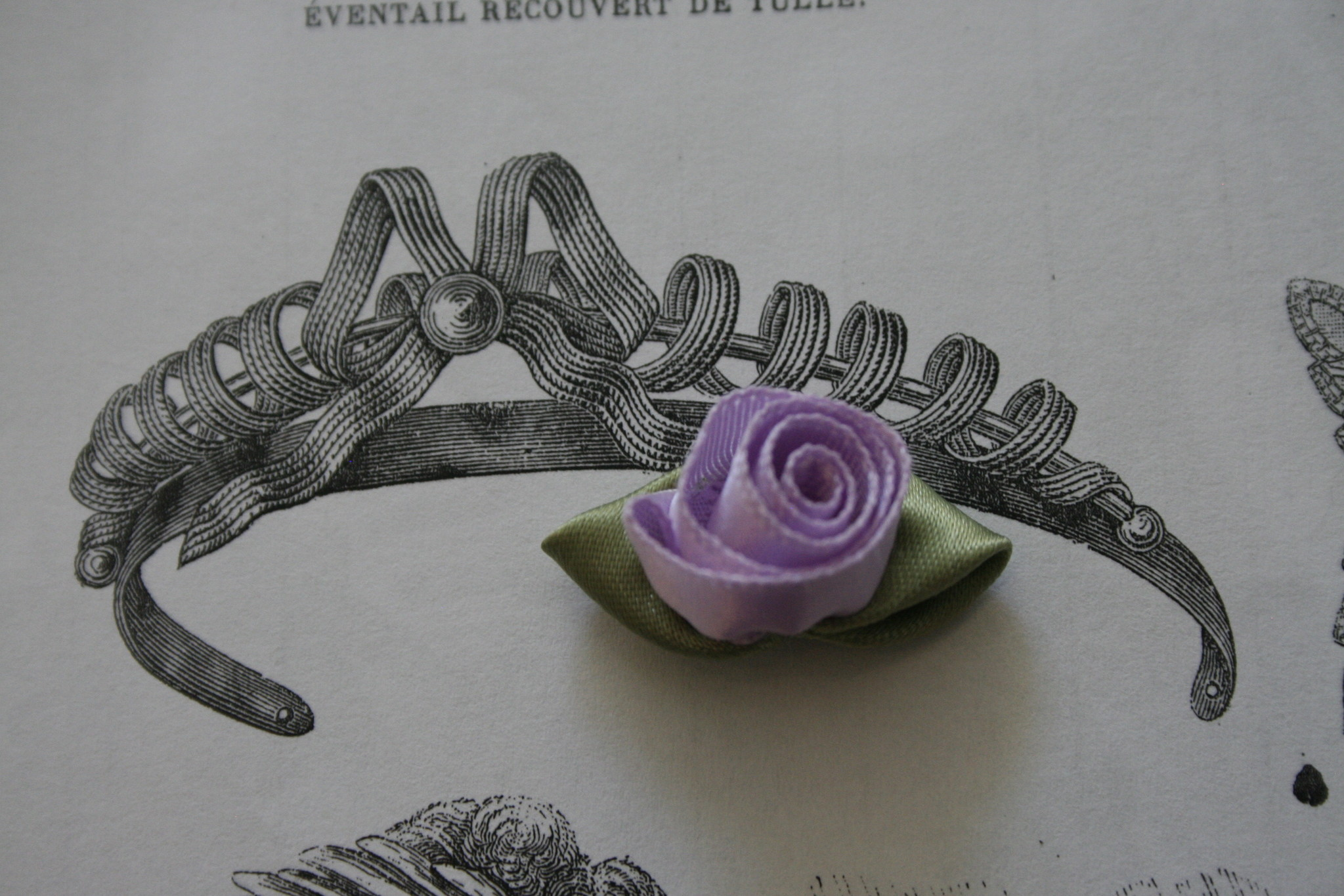 Lilac satin roses with leaves.