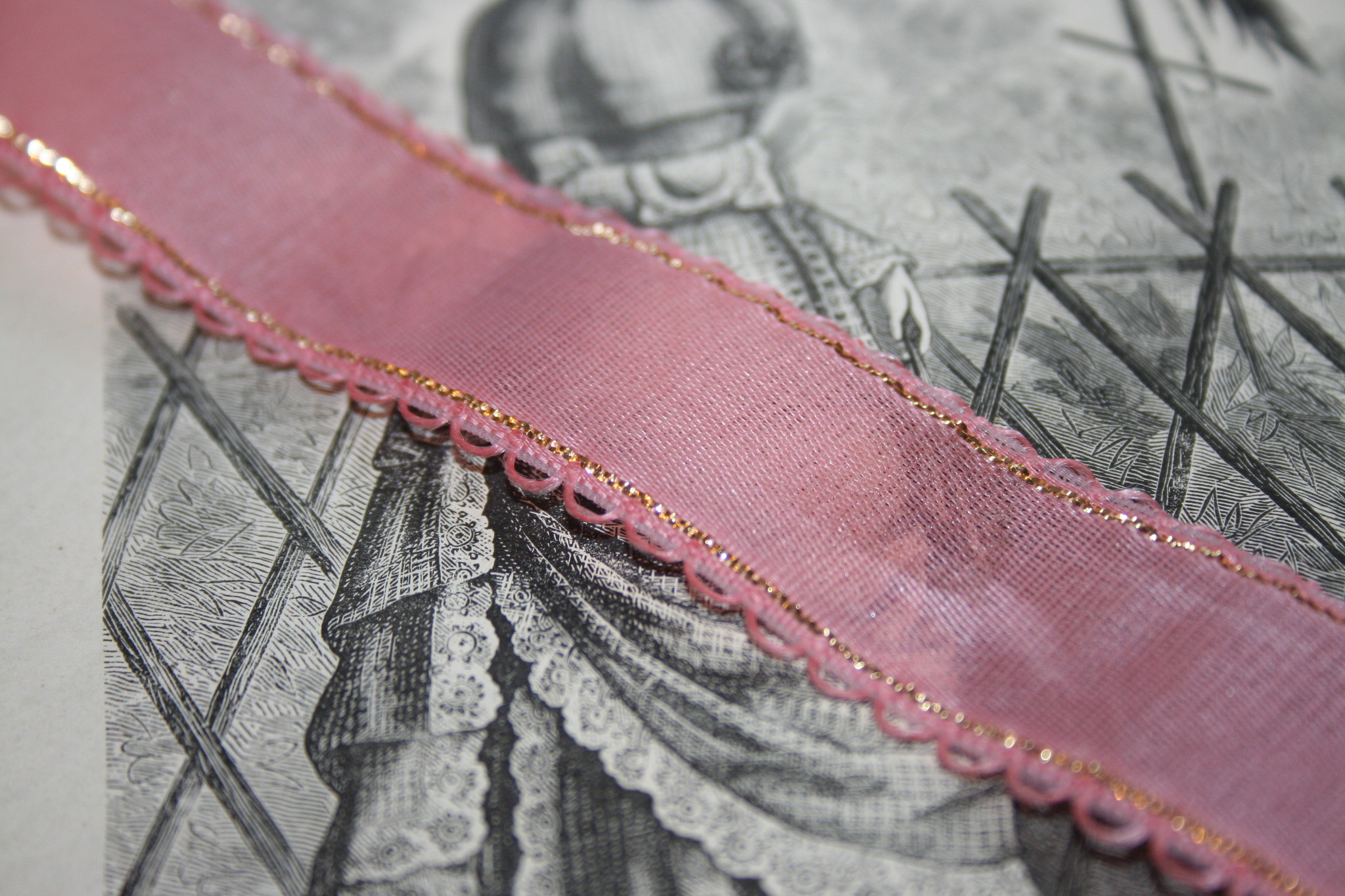 Vintage pink gauze ribbon with gold edge.