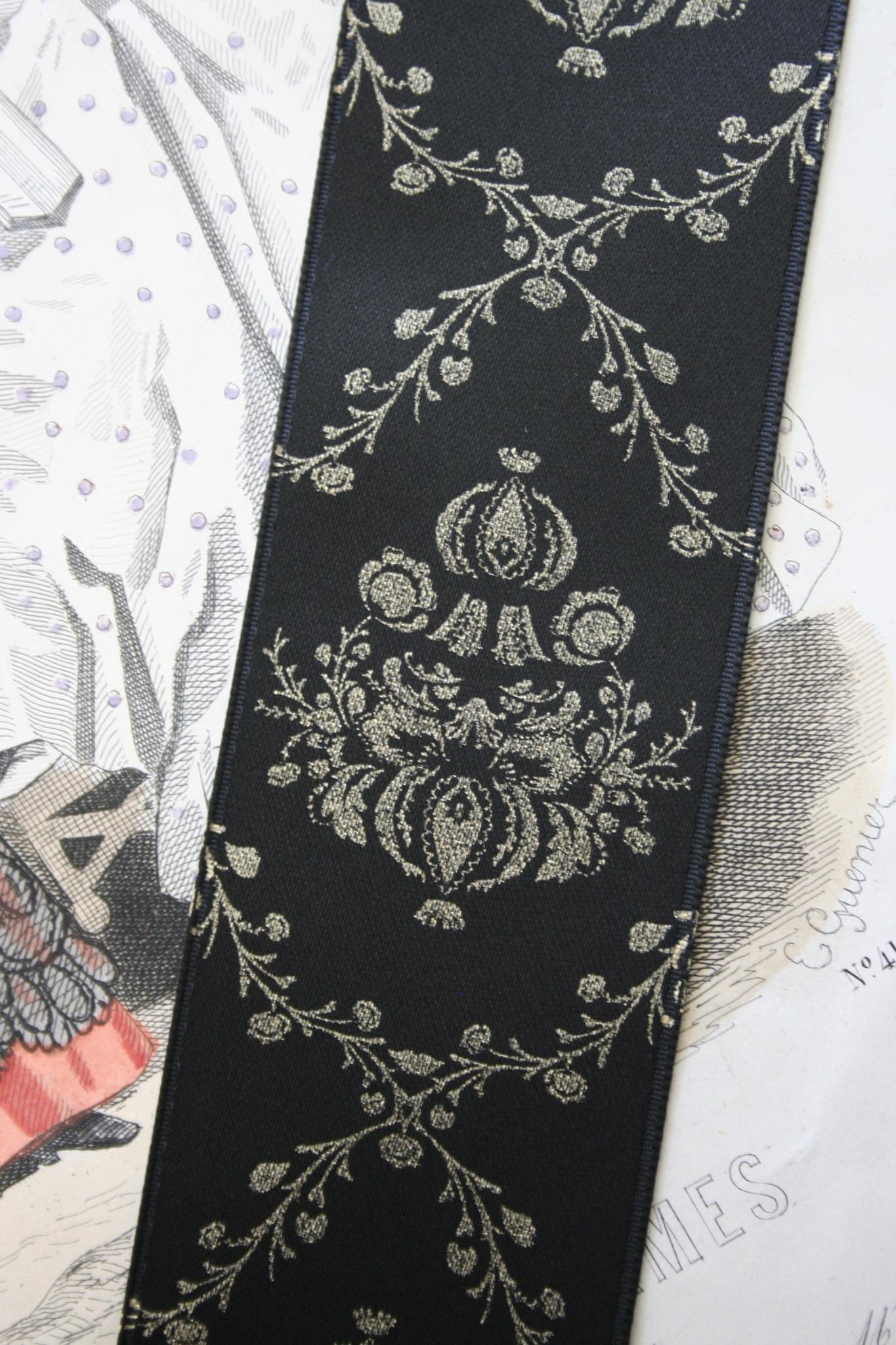 Black satin ribbon with gold Baroque print 40mm.