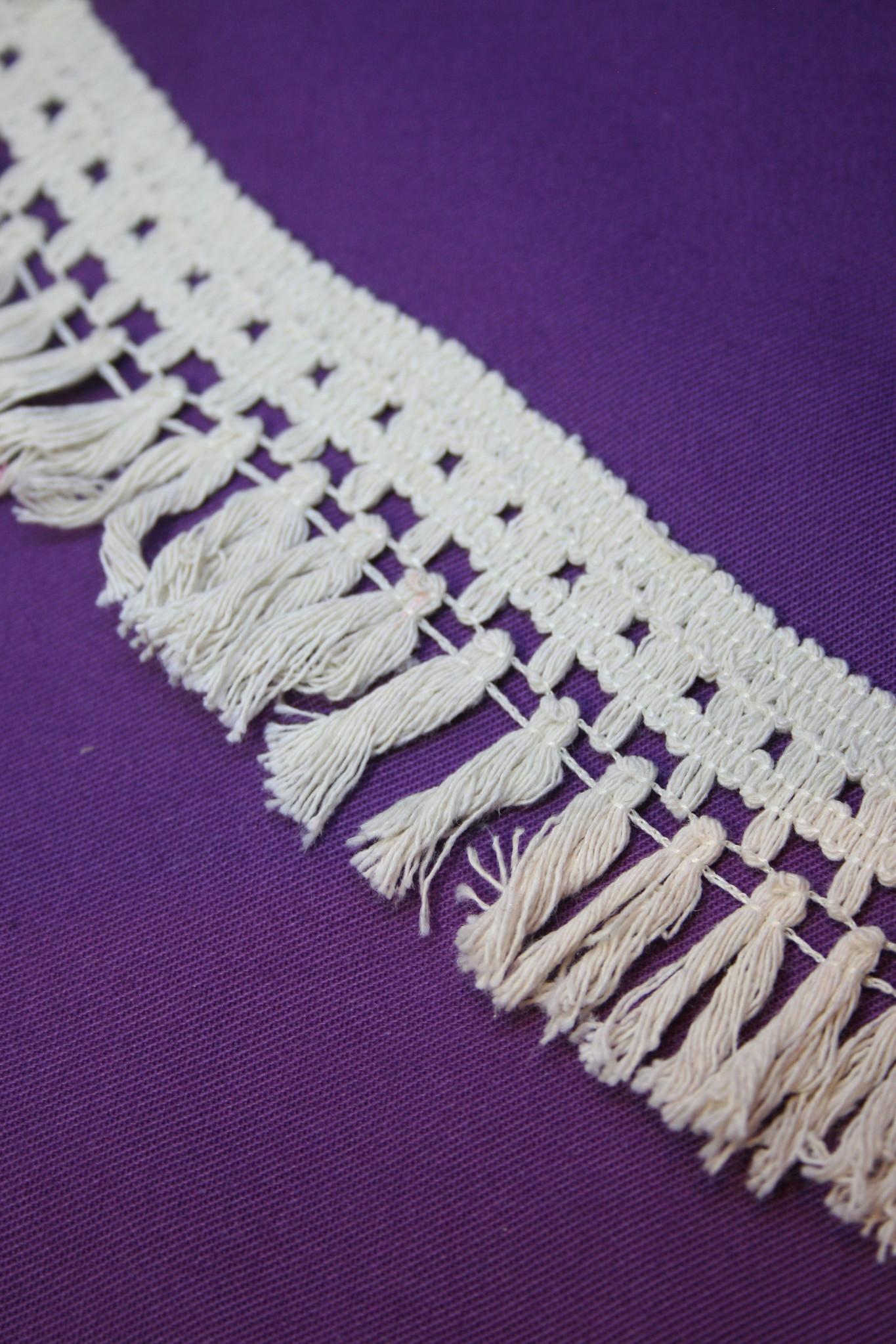Unbleached cotton tassle trim.