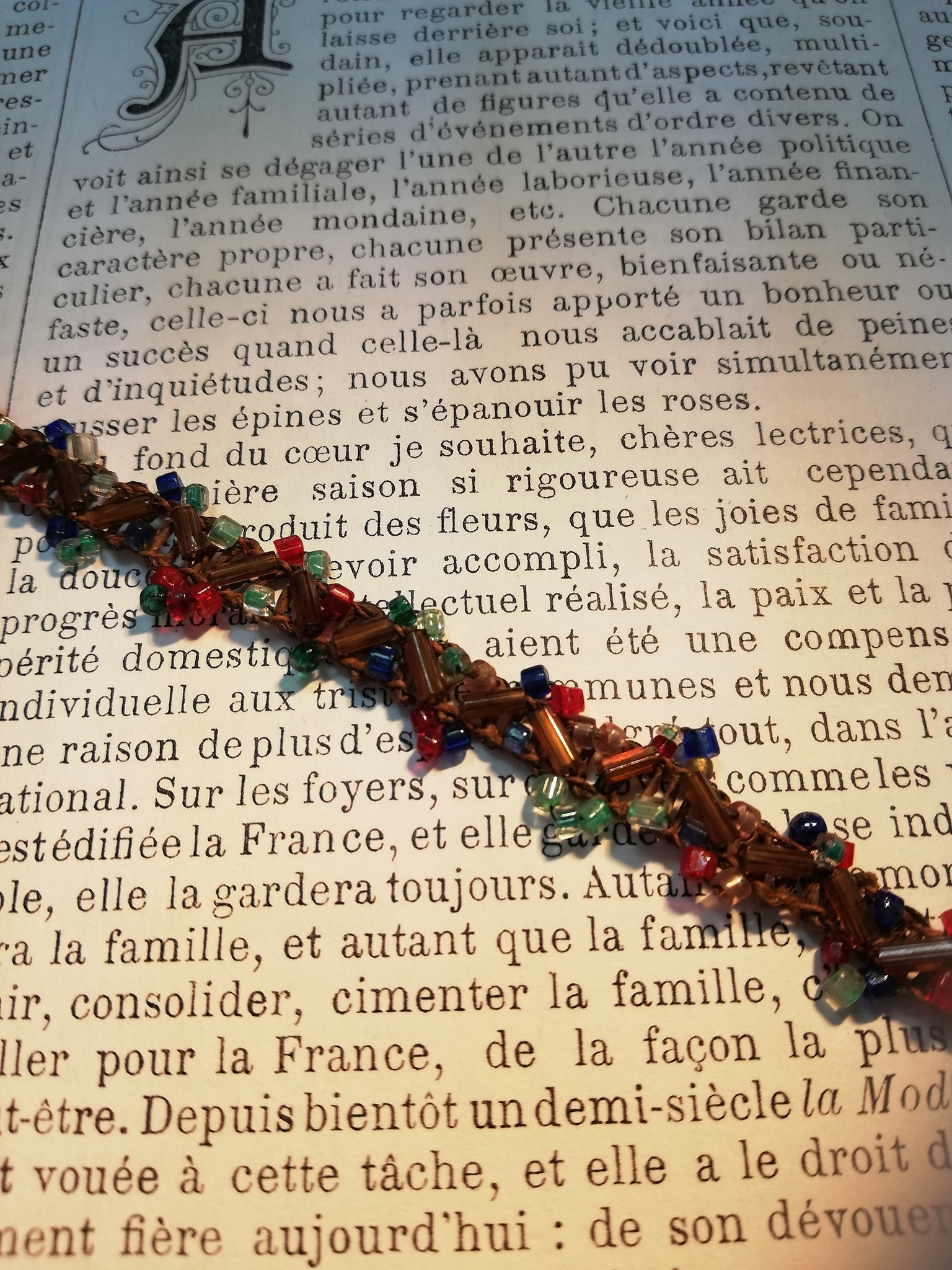 Vintage multi colored beaded trim.