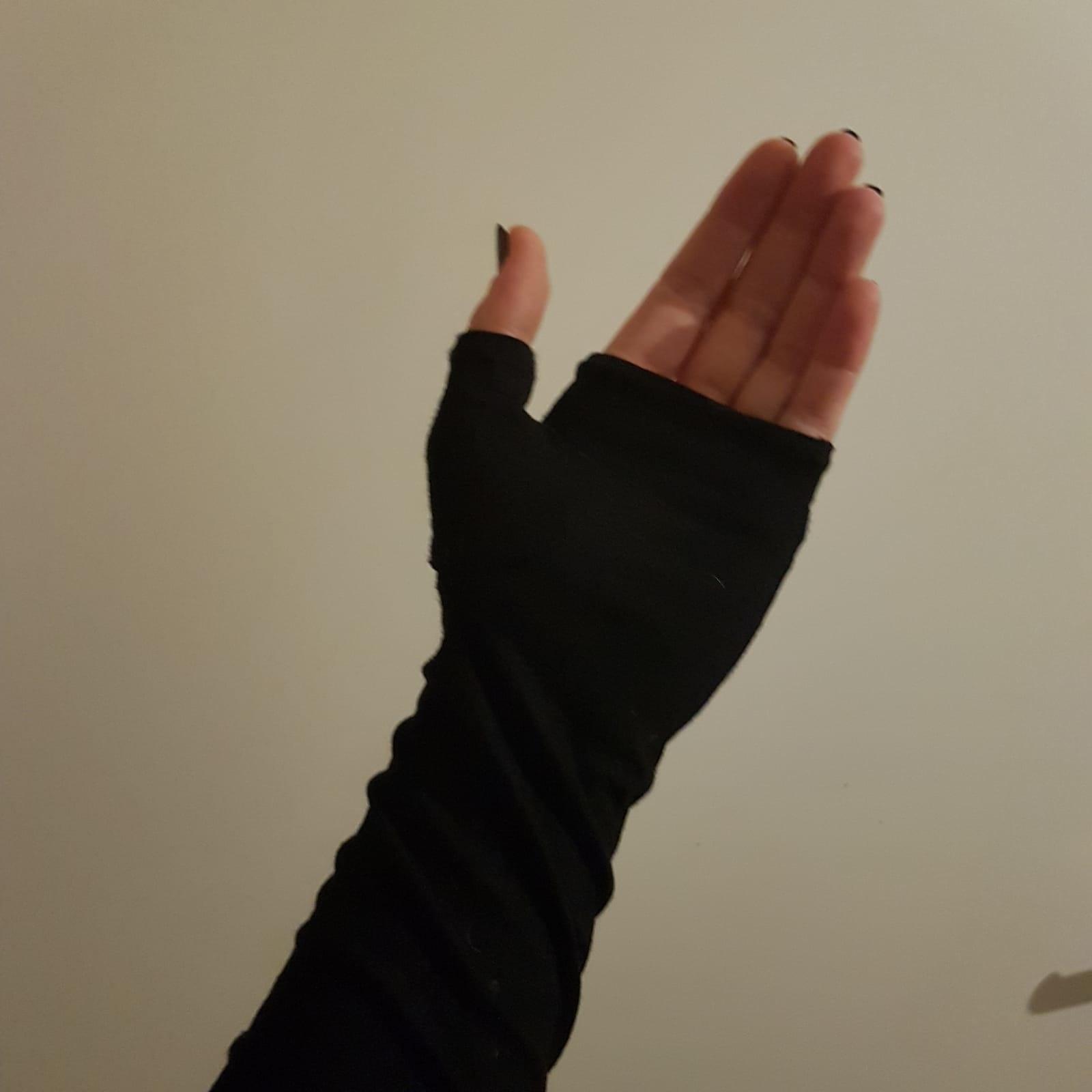 Cotton opera length fingerless gloves.