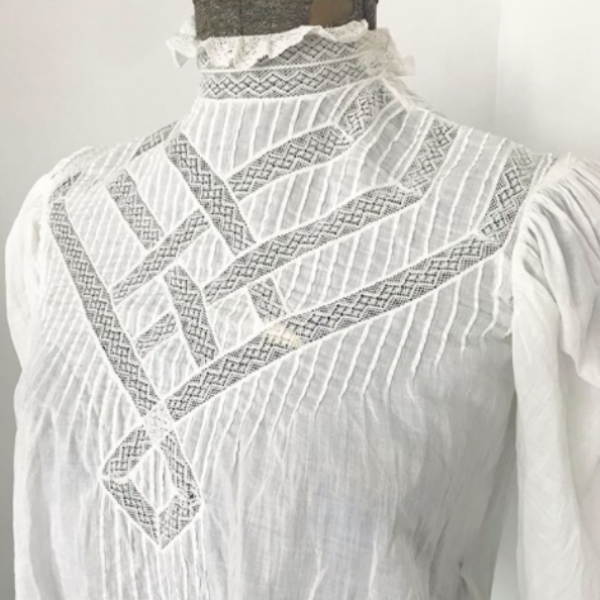 White Broderie insertion lace.
