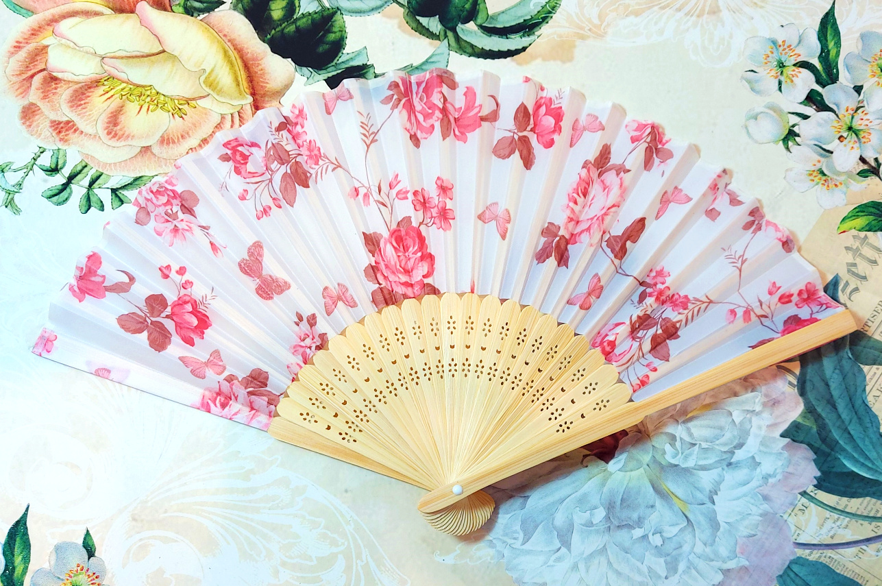 Fan with rose fabric.