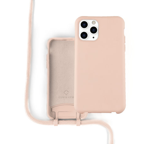 Coverzs Coverzs Silicone case met koord iPhone 12 / 12 Pro (roze)